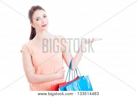 Woman Carrying Shopping Bags Smiling And Showing Blank Space