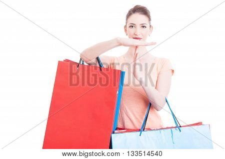 Woman Holding Shopping Bags Making Time Out Gesture