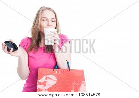 Portrait Of Beautiful Young Shopper Smelling And Enjoying Coffee