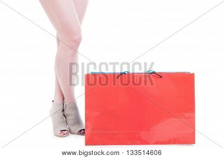 Shopper Concept With Young Female Legs Standing Near Shopping Bags
