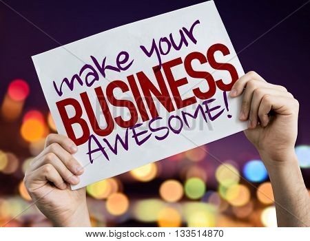 Make Your Business Awesome placard with night lights on background