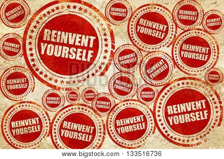 reinvent yourself, red stamp on a grunge paper texture