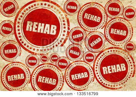 rehab, red stamp on a grunge paper texture