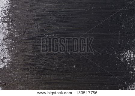 The dark grunge wood textured wall closeup