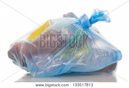Blue garbage bag with household waste isolated on white background.