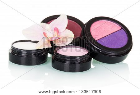 Eye shadow, blush and orchid flower isolated on white background.