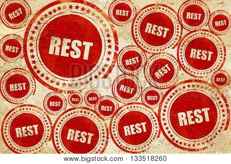 rest, red stamp on a grunge paper texture