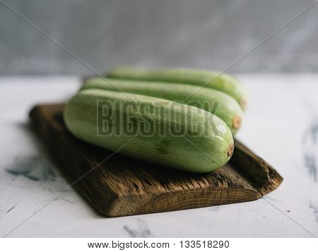 Composition with fresh a green squash. Fresh organic vegetables. Healthy eating concept