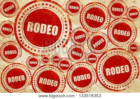rodeo, red stamp on a grunge paper texture