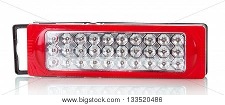 Plastic red LED flashlight isolated on a white background.