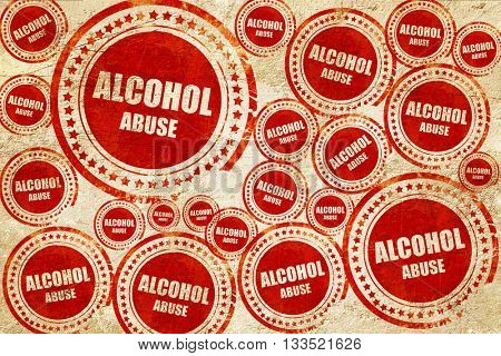 Alcohol abuse sign, red stamp on a grunge paper texture