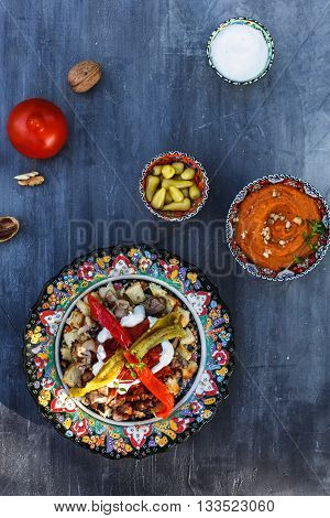 Turkish Kebab iskender doner in traditional plates, top view