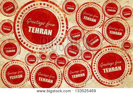 Greetings from tehran, red stamp on a grunge paper texture