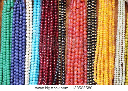 Abstract photo of a number of hanging necklaces ideal for use as a background