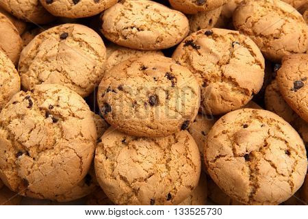 Lots of cookies and biscuits background. Sweet chocolate chips biscuits and cookies texture background.