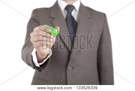 Businessman writing with green marker isolated on white with clipping path