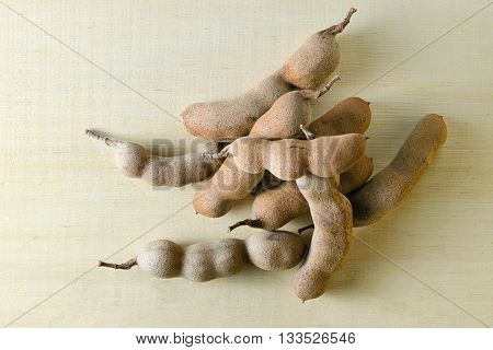 Tamarind or bitter gourd (Other names are Cucurbitaceae bitter gourd balsam apple balsam pear bitter cucumber bitter melon tamarind) isolated on wood background