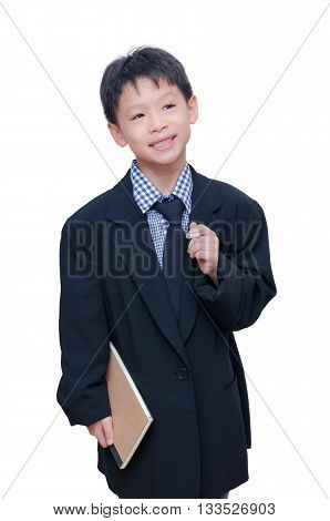 Little Asian boy in big suit over white