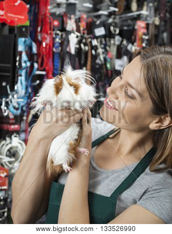 Saleswoman Looking At Cute Guinea Pig