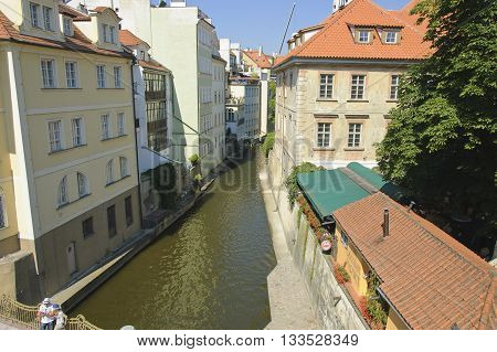 Prague Czech - 03 July 2015: Certovka channel which separates Campa Island from the Lesser Town of Prague. Buildings on its banks gave this place the name of the 'Prague Venice'