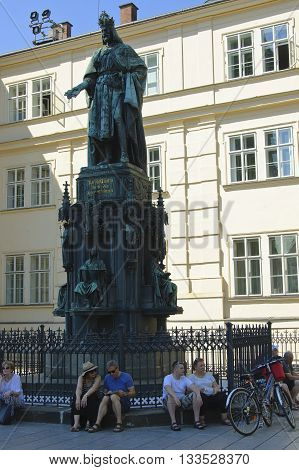Prague Czech - 03 July 2015: Krizovnicke square. People sitting under monument of Holy Roman Emperor Charles IV