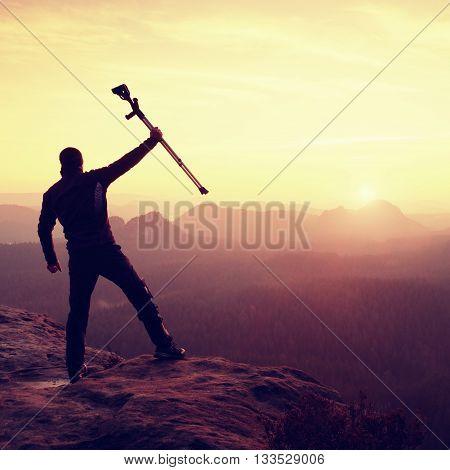 Happy Man Ill Man Celebrate Peak Achievement. Tourist  With Broken Leg