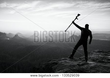 Man With Broken Leg And Medicine Crutch.  Hiker With Leg In Immobilizer Achieve Peak