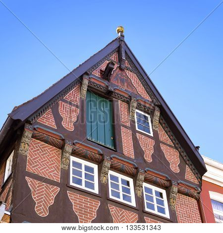 Old townhouse facade. Middle age house. Half-timbered house of the dark age in an old town of North Germany.
