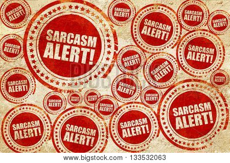 sarcasm alert, red stamp on a grunge paper texture