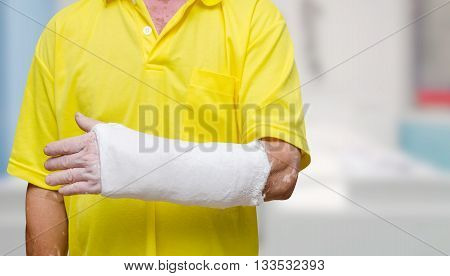 Man with his broken left arm at hospital
