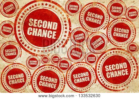 second chance, red stamp on a grunge paper texture