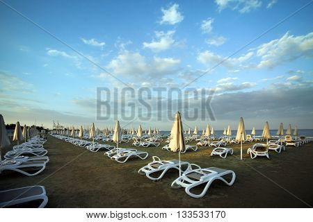 Mediterranean beach with umbrella in Larnaca, Cyprus.