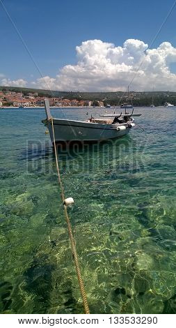 Fishing boat moored on the crystal clear waters in Primosten, Croatia