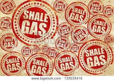 shale gas, red stamp on a grunge paper texture