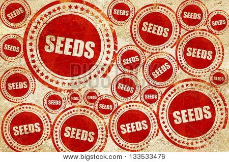 seeds, red stamp on a grunge paper texture