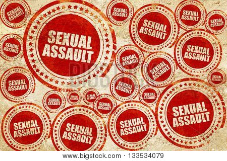sexual assault, red stamp on a grunge paper texture