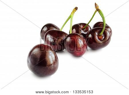 Sweet cherry berries on a white hum noise. Seven objects isolated on a white hum noise with a shadow. Dark and claret color. Indoors. Horizontal format. Color. Photo.