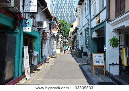 SINGAPORE - 05 JUN 2016: On the streets Arab quarter (Kampong Glam). Arab Quarter is the oldest historic shopping district of Singapore is popular for visiting tourists.