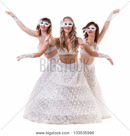 Three carnival dancer women wearing a mask dancing, isolated on white background in full length.