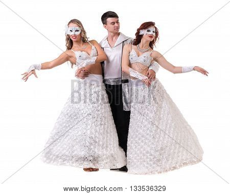 Three carnival dancers wearing a mask dancing, isolated on white background in full length.