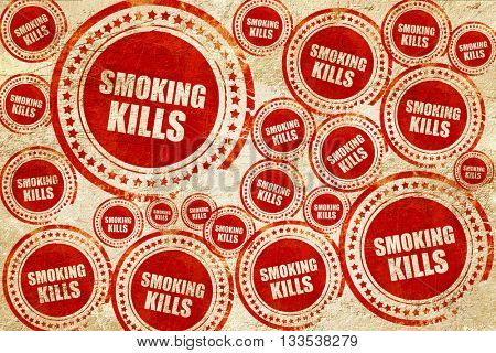 smoking kills, red stamp on a grunge paper texture