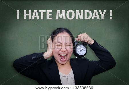 I Hate Monday! written on blackboard with Asian business woman screaming