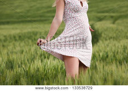 girl legs in the grass enjoy life