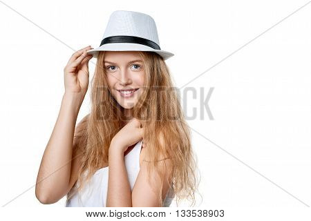 Closeup of smiling woman wearing white fedora straw hat over white background
