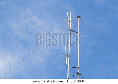 Antenna mobile transmitter antenna radio communication Sky background.