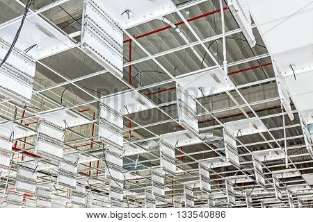 Mounting neon on suspended office ceiling futuristic white office ceiling