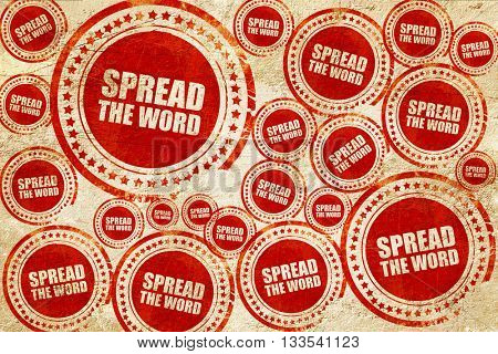 spread the word, red stamp on a grunge paper texture