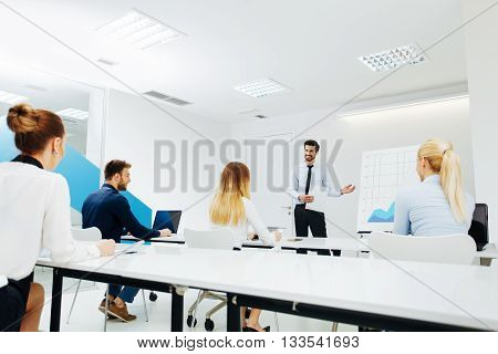 Businessman lecture to his colleagues at presentation in the conference room