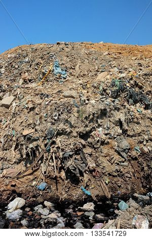 Plastic bags household trash and hazardous industrial waste contaminates land soil and water at Bali's largest and most polluted landfill site in Suwung Bali Indonesia.