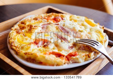 Scrambled eggs with bacon and tomato. Bon Appetit